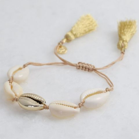 SHELL BRACELET WITH GOLD CENTRAL SHELL WITH GOLD TASSEL FASTENING